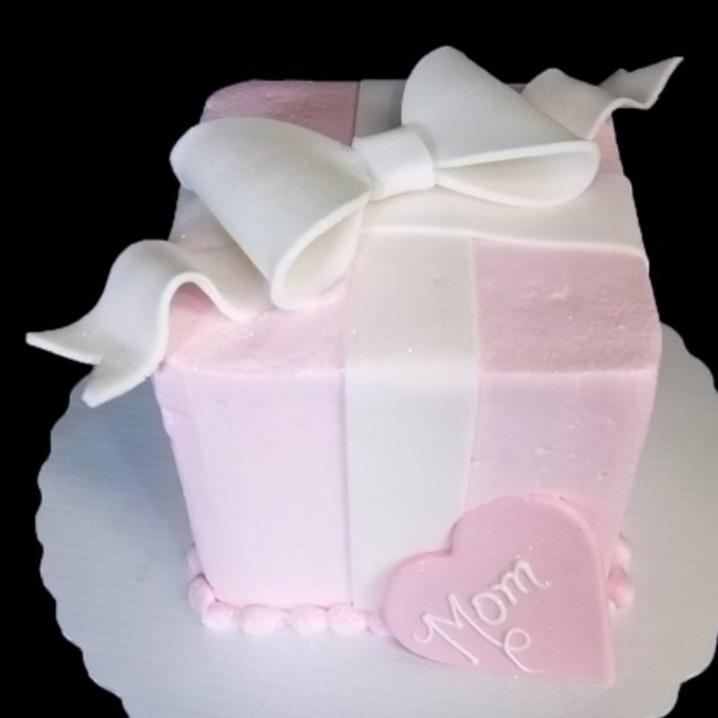 Small square cake shaped like a present with a bow