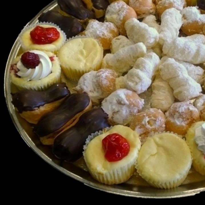 Assorted mini pastries on a tray.