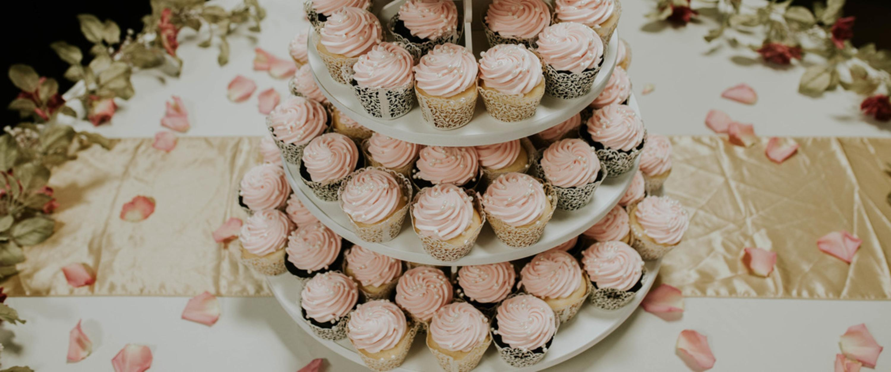 Delicate pink cupcakes with pearls and floral accents
