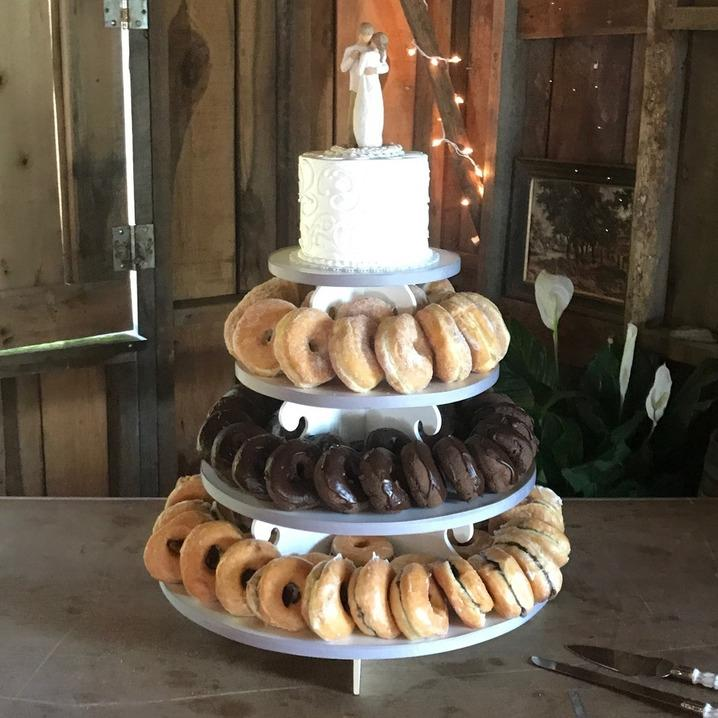 Small tiered donut tower with mini wedding cake on top
