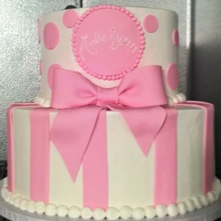 Pink tiered cake with big bow